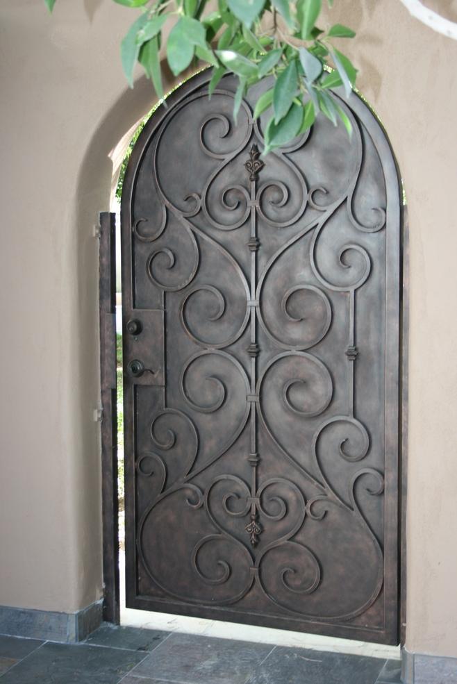 Porte dentre en fer forg porte en fer porte en for Porte spanish